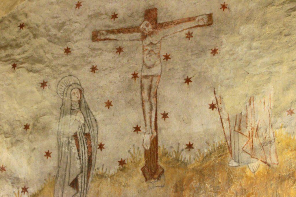 Rymättylän kirkon seinämaalauksia, jossa Jeesus ristillä.