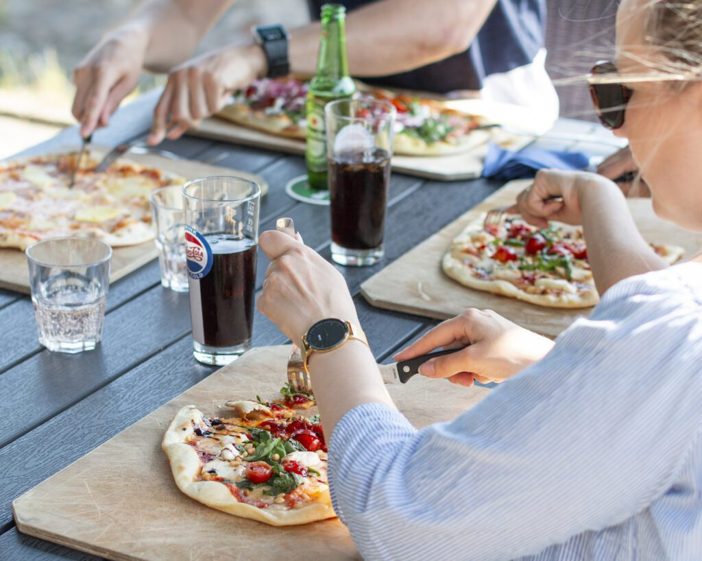 Heineken House pitsat ja ruokailijoita.