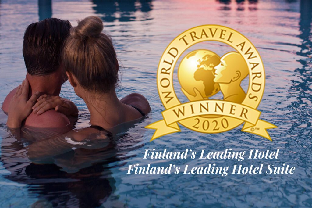 Mies ja nainen altaassa, sinisenpurppura vesi, kuvan päällä World Travel Awards -logo.